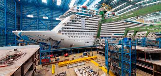 Norwegian Escape floats out of Meyer Werft building dock