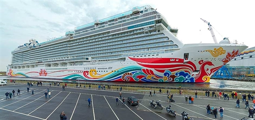 Norwegian Joy floats out from building dock at Meyer Werft